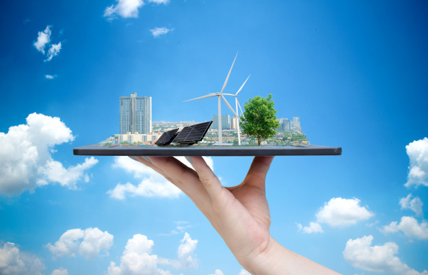 ecological-system-solar-energy-city-hand-holding-tablet_33807-434